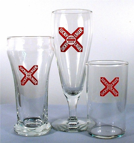 Thre styles of early Lucky Lager beer glasses.